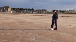 Bill Lindsay offered to take photos for this young couple from Texas on St Andrews West beach.