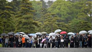 People outside the Imperial Palace in Tokyo