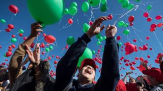 in_pictures Children releasing red and green balloons in Marrakesh, Morocco - Wednesday 20 November 2019