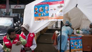 Doctors and nurses from Madagascar Ministry of Health and officers of Malagasy Red Cross staff for one healthcare checkpoint near bus stop for Antananarivo on October 5,