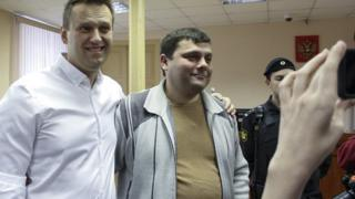 Russian opposition leader Alexei Navalny, left, poses with his former colleague Pyotr Ofitserov in the court in Kirov, Russia, Wednesday, Feb. 8, 2017