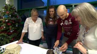Testing the Christmas pudding (Christine Dodd on left)