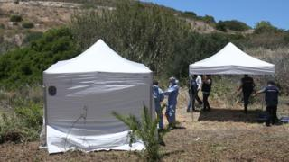in_pictures Forensic police officers prepare to examine an area of wasteland to search for Madeleine McCann in the town of Praia da Luz, Portugal