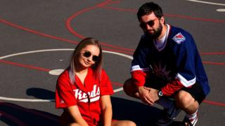 Kieran and his girlfriend Alannah pose in vintage sportswear to promote his vintage shop