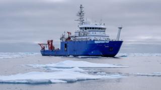 the research vessel Sikuliaq among icebergs