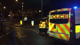 Police vans on Hylton Road following the attempted robbery