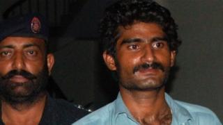 Murder suspect Waseem (R)