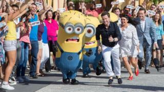Declan Donnelly, Scarlett Moffatt and Stephen Mulhern with a group of minions during filming