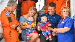Pictured (left to right) are Chief Crewman Ian Copley, Jennie, Jenson, Ruben, Rich and Midwife Jane Parke who accompanied Jennie on the flight