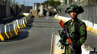 Iraqi soldier guards the Green Zone (file photo)
