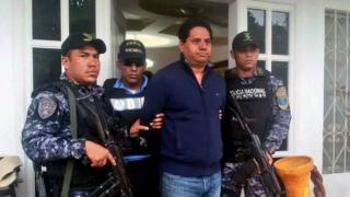 Mayor Delvin Salgado, flanked by police, being arrested