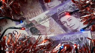 Money and christmas tinsel