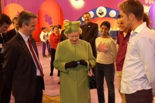 The Queen is presented with a Blue Peter badge
