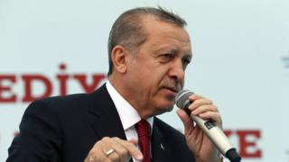 President Recep Tayyip Erdogan addresses his supporters during an opening ceremony in Istanbul.