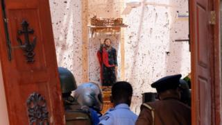 A statue of St. James is pictured after a bomb blast inside a church in Negombo