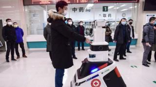 man-checked-in-hospital-by-robot