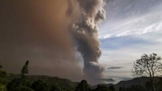 An ash column from Taal volcano looms over Tagaytay city, Philippines, 12 January 2020.