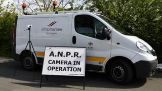 Infrastructure department van with ANPR camera and sign