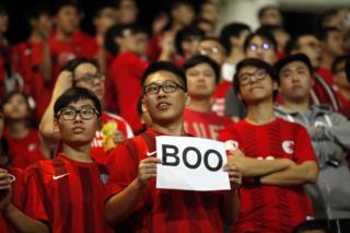 Hong Kong fans cheer their team during a world cup qualifier at Mong Kok stadium in Hong Kong on 17 November 2015