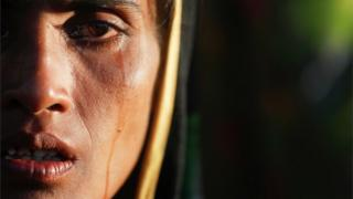 Close-up of a Rohingya woman crying in a refugee camp in Bangladesh (Oct 2017)