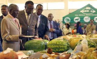 Zimbabwean President Robert Mugabe (L) and his Namibian counterpart Hage Geingob (2-L) and Zimbabwean Minister of Agriculture Sen Joseph Mtekwese Made (3-L) visit one of the exhibition stands at the 2017 edition of the Zimbabwe International Trade Fair in Bulawayo, Zimbabwe, 28 April 2017. The fair is for local and international traders and business people to showcase ideas and new products