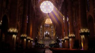 Bishop Sebastia Taltavull performs Mass at a deserted cathedral in Palma de Mallorca, Spain