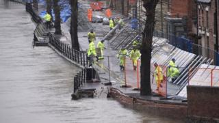 environment Environment Agency teams work on temporary flood barriers in the Wharfage area of Ironbridge, Shropshire