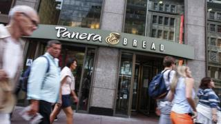 People walk past Panera Bread branch