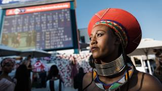 A women looks up at the clock during the 2018 edition of the Vodacom Durban July horse race in Durban, on July 7, 2018
