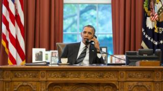 President Barack Obama talks with President Hassan Rouhani of Iran during a phone call in the Oval Office.