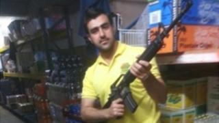 Hakim Nasiri shown with gun - pic via Italian police