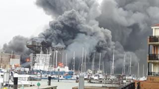 Plumes of black and grey smoke