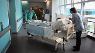 Patient being wheeled in a hospital bed