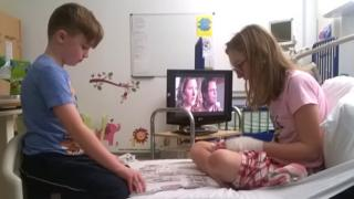 Bex Price with her brother Sam in Great Ormond Street Hospital