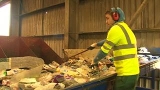 Recycling waste being sorted at facility in Buckley, Flintshire