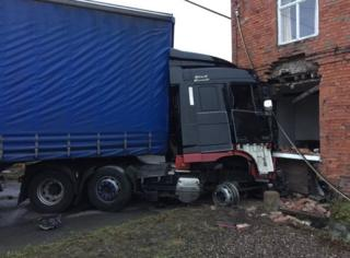 Lorry and house