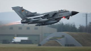 A Bundeswehr Tornado reconnaissance jet departs for Incirlik airbase on December 10, 2015