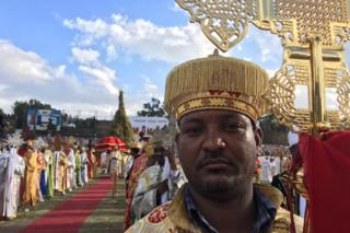 A priest stands in Meskel Square