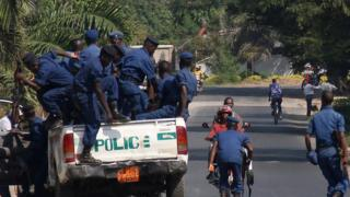 Burundian police arrive to set up a road block in the Burundian capital on July 6, 2015