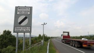 Traffic passes a border sign at Newry as you enter Northern Ireland from the south