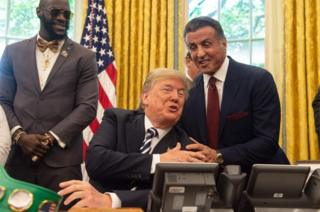 Actor Sylvester Stallone and boxer Lennox Lewis were present for the pardon signing