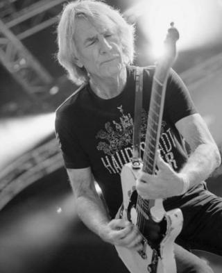 Rick Parfitt playing his guitar