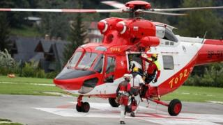Members of the Mountain Rescue Team (TOPR) board a helicopter in Poland. August 18