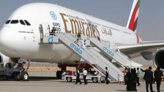 """Visitors look at an Emirates airline""""s Airbus A380 dislayed at the Dubai Airshow"""