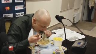 The journalist eating his newspaper soup