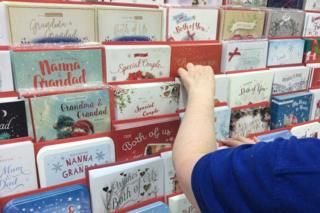 Shop manager sorting Christmas cards in Card Factory