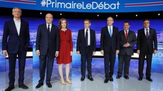 Candidates for the right-wing Les Republicains (LR) party primaries ahead of the 2017 presidential election: L to R Bruno Le Maire, Alain Juppe, Nathalie Kosciusko-Morizet, Nicolas Sarkozy, Jean-Francois Cope, Jean-Frederic Poisson and Francois Fillon pose before the first televised debate between the seven candidates for France's right-wing presidential nomination, on 13 October 2016 at the studios of French private television channel TF1 in La Plaine-Saint-Denis, north of Paris