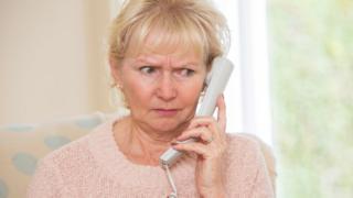 Worried woman on phone