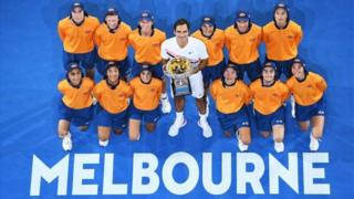 Roger Federer holds the Australian Open trophy