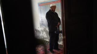 "This photo taken on April 16, 2015 shows a Uighur man praying in a mosque in Hotan, in China""s western Xinjiang region."